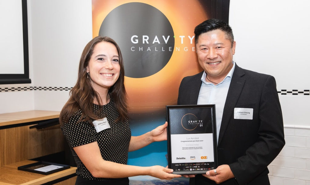 Lux Aerobot's Katrina Albert receives a GRAVITY Challenge Award from Oz Minerals' Richard Cheung during Space Week in Adelaide, November 2019.