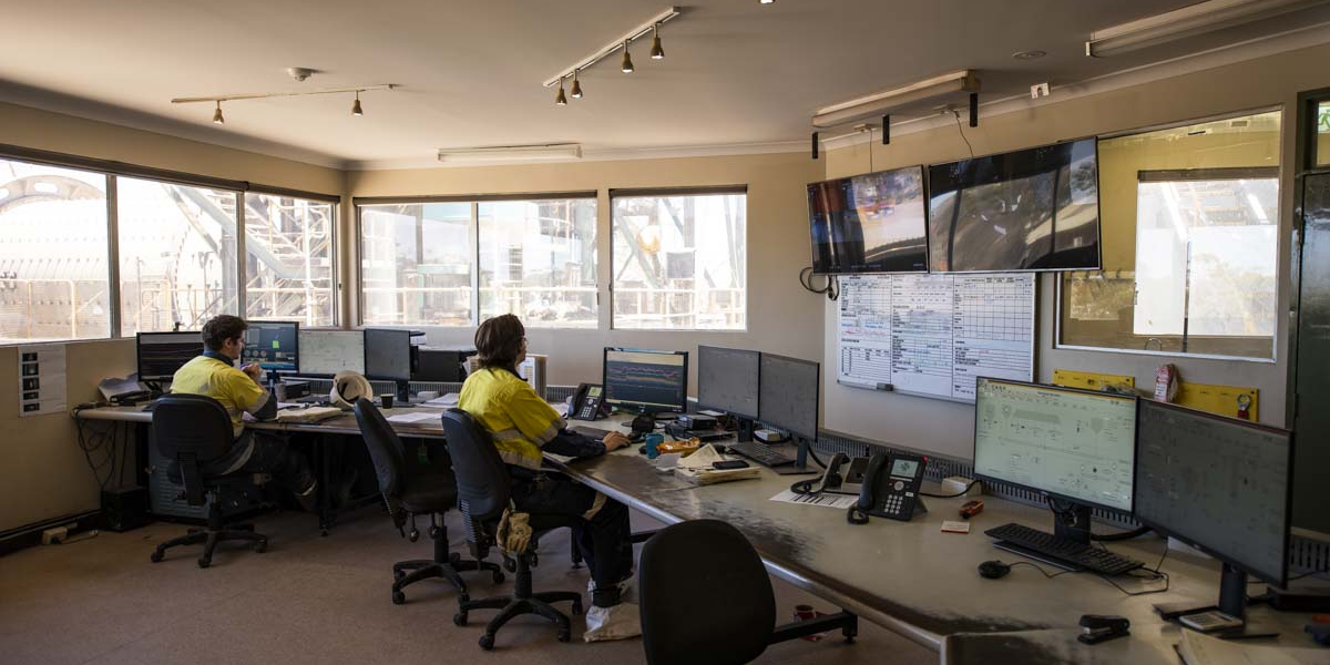Mine workers in control centre