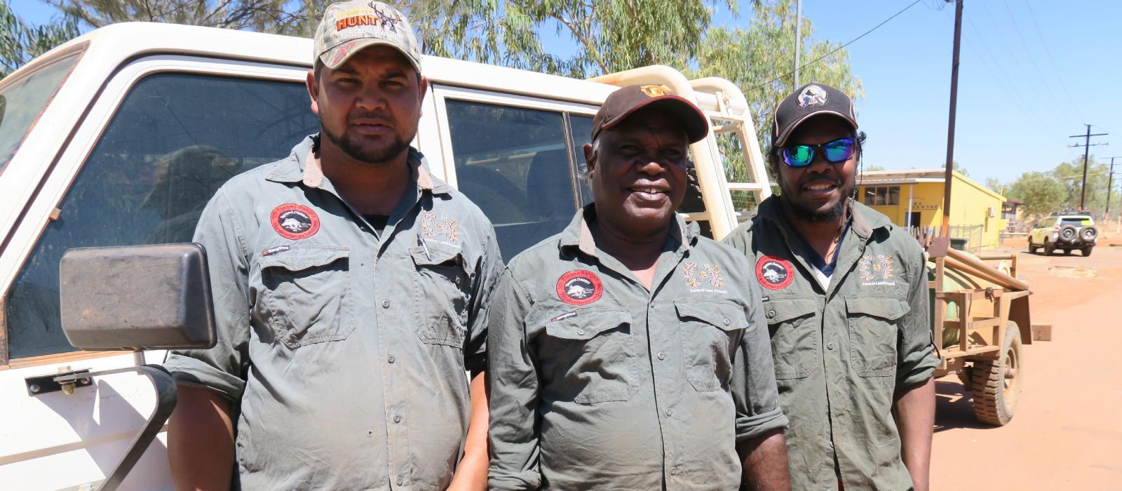 3 rangers smiling at camera