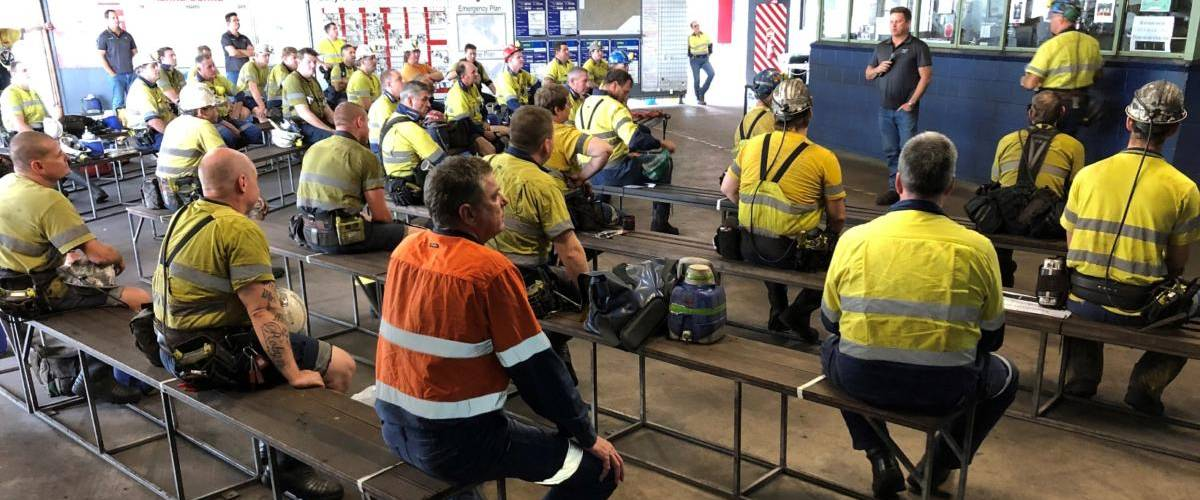 mine workers socially distanced